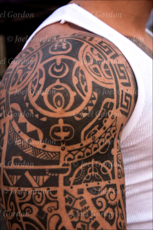 Tribal Tattoo Sleeve on his shoulder and down his arm.<br /> <br /> Body art or tattoos has entered the mainstream it is no longer considered a weird kind of subculture.<br /> <br /> &quot;According to a 2006 Pew survey, 40% of Americans between the ages of 26 and 40 have been tattooed&quot;.