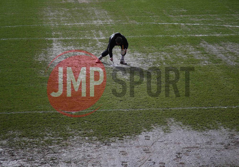 A groundstaff member paints the penalty spot - Photo mandatory by-line: Robin White/JMP - Tel: Mobile: 07966 386802 08/02/2014 - SPORT - FOOTBALL - Charlton - The Valley - Charlton Athletic v Birmingham City - Sky Bet Championship