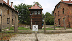 A guard tower and barracks surrounded by barbed wire fences at the Auschwitz-Birkenau Nazi concentration camps in Auschwitz, Poland on September 3, 2017. Auschwitz concentration camp was a network of German Nazi concentration camps and extermination camps built and operated by the Third Reich in Polish areas annexed by Nazi Germany during WWII. It consisted of Auschwitz I (the original camp), Auschwitz II–Birkenau (a combination concentration/extermination camp), Auschwitz II–Monowitz (a labor camp to staff an IG Farben factory), and 45 satellite camps. In September 1941, Auschwitz II–Birkenau went on to become a major site of the Nazi Final Solution to the Jewish Question. From early 1942 until late 1944, transport trains delivered Jews to the camp's gas chambers from all over German-occupied Europe, where they were killed en masse with the pesticide Zyklon B. An estimated 1.3 million people were sent to the camp, of whom at least 1.1 million died. Around 90 percent of those killed were Jewish; approximately 1 in 6 Jews killed in the Holocaust died at the camp. Others deported to Auschwitz included 150,000 Poles, 23,000 Romani and Sinti, 15,000 Soviet prisoners of war, 400 Jehovah's Witnesses, and tens of thousands of others of diverse nationalities, including an unknown number of homosexuals. Many of those not killed in the gas chambers died of starvation, forced labor, infectious diseases, individual executions, and medical experiments. In 1947, Poland founded a museum on the site of Auschwitz I and II, and in 1979, it was named a UNESCO World Heritage Site. Photo by Somer/ABACAPRESS.COM