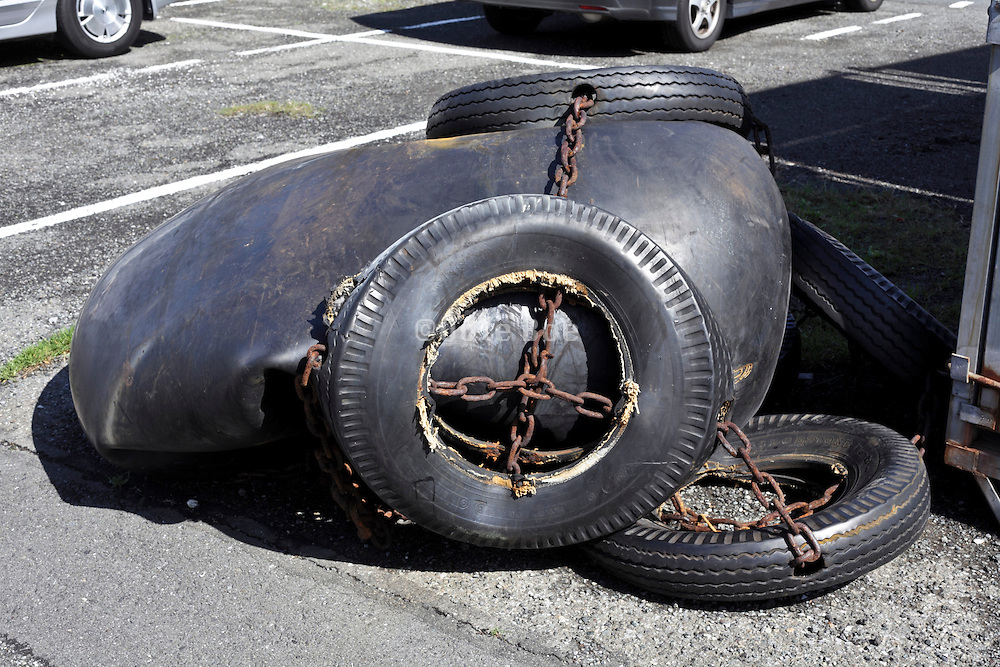 tires with chains at an industrial area car parking