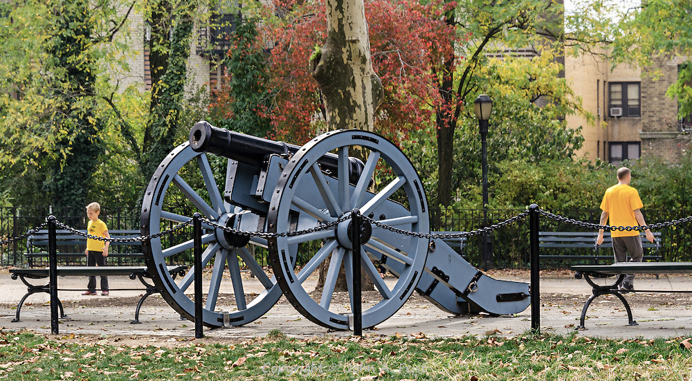We're still not sure why the city of New York included this cannon when they renovated Bennett Park in upper Manhattan.  I was very amused to capture not only the cannon, but the man and boy facing opposite directions while wearing matching yellow shirts.
