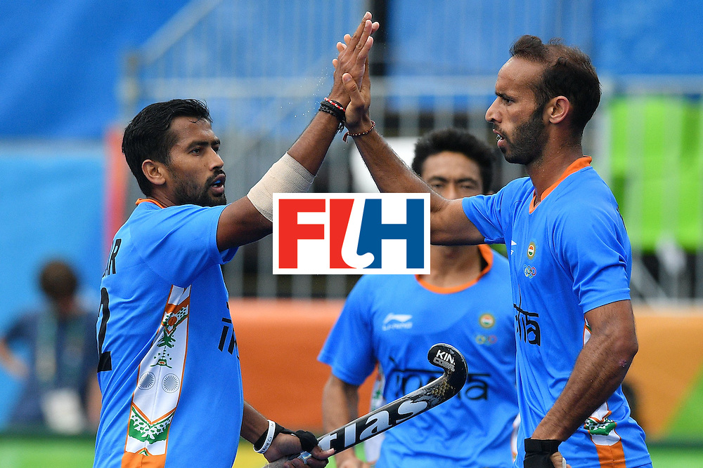 India's Ramandeep Singh celebrates scoring with his teammates during the mens's field hockey India vs Canada match of the Rio 2016 Olympics Games at the Olympic Hockey Centre in Rio de Janeiro on August, 12 2016. / AFP / Carl DE SOUZA        (Photo credit should read CARL DE SOUZA/AFP/Getty Images)