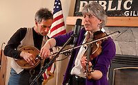 "Fiddler Ellen Carlson accompanied by Tim Mowry on guitar entertains visitors to the Gilford Library with two renditions of ""Stay All Night Don't Want to Go Home""  along with Irish, Scottish, Bluegrass and Jazz fiddling tunes on Thursday evening.  (Karen Bobotas/for the Laconia Daily Sun)"
