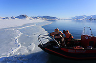 Marine chemists Agneta Fransson (Norwegian Polar Institute) and Melissa Chierici (Institute of Marine Research) collect data about fjord ice and carbon cycle in frozen fjord; Kongsfjorden, Svalbard, Norway.