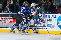 KELOWNA, CANADA - MARCH 11: Tomas Soustal #15 of Kelowna Rockets digs for the puck as Ryan Gagnon #3 of Victoria Royals checks him into the boards on March 11, 2015 at Prospera Place in Kelowna, British Columbia, Canada.  (Photo by Marissa Baecker/Shoot the Breeze)  *** Local Caption *** Ryan Gagnon; Tomas Soustal;