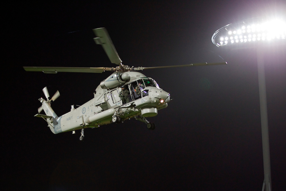 A Navy Seasprite Helicopter delivers the match ball for the Chiefs v Sharks in a Super Rugby match, Waikato Stadium, Hamilton, New Zealand, Saturday, April 27, 2013.  Credit:SNPA / David Rowland