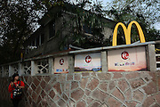 HANGZHOU, CHINA - NOVEMBER 15: (CHINA OUT) <br /> <br /> Chiang Ching-kuos Former Residence Turns Into A McDonalds<br /> <br /> Tourists play outside of Chiang Ching-kuos villa near West Lake on November 15, 2015 in Hangzhou, Zhejiang Province of China. Former Taiwan leader Chiang Ching-kuo, son of former Kuomintang leader Chiang Kai-shek, lived with his family in this two-story villa built in 1931 from the end of the War of Resistance against Japanese Aggression (1937-45) until they left for Taiwan in 1949. Two months earlier a Starbucks outlet opened in the side wing of the same house, the report said and now it still open a McDonald's in this historical villa. Controversy goes about in public that the old residence turning into a commercial place would go against the preservation of the historical site<br /> ©Exclusivepix Media