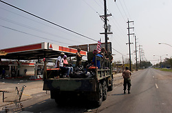 05 Sept  2005. New Orleans, Louisiana. Post hurricane Katrina.<br /> Some of the last evacuees are rescued from the Chef Menteur Highway (I-90) in Chalmette in the ghost town that once was New Orleans.<br /> Photo; ©Charlie Varley/varleypix.com