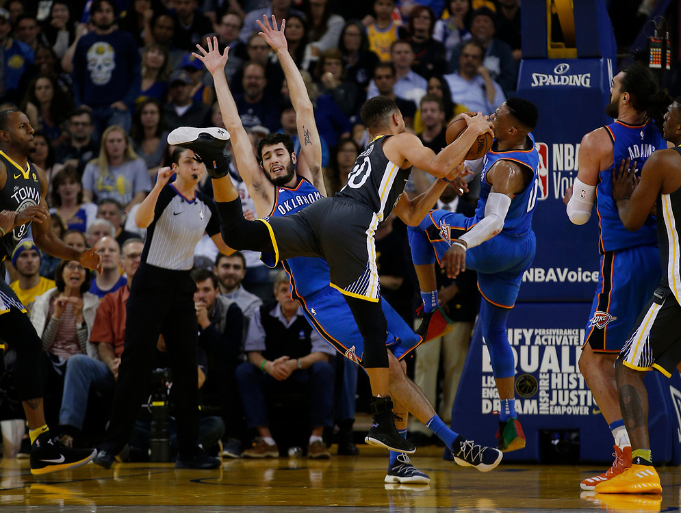 Golden State Warriors guard Stephen Curry (30) is fouled during the second half of an NBA game between the Warriors and Oklahoma City Thunder at Oracle Arena, Tuesday, Feb. 6, 2018, in Oakland, Calif. The Warriors lost 105-125.