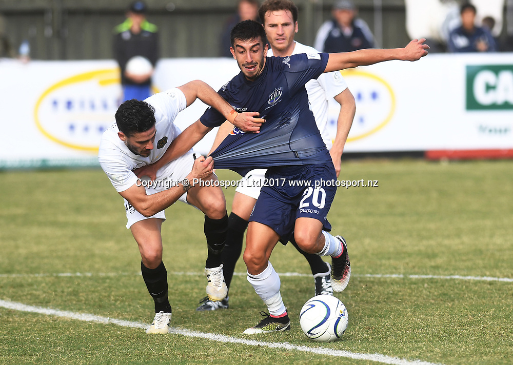 Team Wellington's Guillermo Moretti pulls the jersey of Auckland FC's Emiliano Tade. Auckland City FC v Team Wellington. OFC Champions League Final. Leg 1. Kiwitea Street, Auckland, New Zealand. Sunday 30 April 2017 © Copyright image: Andrew Cornaga / www.photosoprt.nz