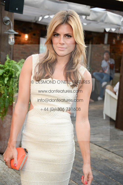 ZOE HARDMAN attending the Warner Bros. & Esquire Summer Party held at Shoreditch House, Ebor Street, London E1 on 18th July 2013.