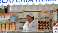 GEPA-2606087320 - WIEN,AUSTRIA,26.JUN.08 - FUSSBALL - UEFA Europameisterschaft, EURO 2008, Host City Fan Zone, Fanmeile, Fan Meile, Public Viewing. Bild zeigt ein Feature mit einem Eisverkaeufer. <br />Foto: GEPA pictures/ Reinhard Mueller