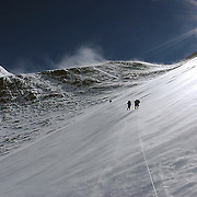 Climbers approach the famed Geneva Spur at 25,000 feet on the Upper Lhotse Face of Mt. Everest, Nepal. The summit of the peak rises behind.