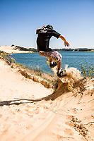 Bruninho sandboarding on the dunes of Arroio Corrente Lagoon. Jaguaruna, Santa Catarina, Brazil. / <br /> Bruninho andando de sandboard nas dunas da Lagoa do Arroio Corrente. Jaguaruna, Santa Catarina, Brasil.