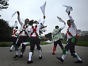© Licensed to London News Pictures. 01/05/2013. Wimbledon, UK The Greensleeves Morris Men welcome in the dawn on May Day with a dance on Wimbledon Common, Surrey, 1st May 2013. Greensleeves were founded in 1926, making it one of the longest established Morris sides. Morris Men dance traditional English folk dance with bells, handkerchiefs, sticks and swords. . Photo credit : Stephen Simpson/LNP