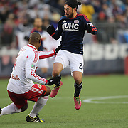 Lee Nguyen, New England Revolution, is challenged by Jamison Olave, New York Red Bulls, during the New England Revolution Vs New York Red Bulls, MLS Eastern Conference Final, second leg. Gillette Stadium, Foxborough, Massachusetts, USA. 29th November 2014. Photo Tim Clayton