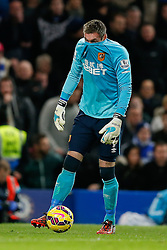 Allan McGregor of Hull City covers his face in his top - Photo mandatory by-line: Rogan Thomson/JMP - 07966 386802 - 13/12/2014 - SPORT - FOOTBALL - London, England - Stamford Bridge - Chelsea v Hull City - Barclays Premier League.