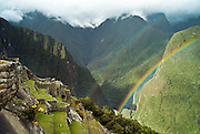 PERU, MACHU PICCHU:  Double rainbows over the ancient Inca terraces of Machu Picchu with the Urubamba river and valley below. Machu Picchu is a pre-Columbian Inca site located 2,430 metres (8,000 ft) above sea level. It was built around 1460 AD but was abandoned as an official site for the Inca rulers a hundred years later, at the time of the Spanish conquest of the Inca Empire.