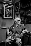 Josef Herman in his studio,<br /> London.<br /> <br /> Josef Herman (1911-2000), also known in Wales as 'Joe Bach' (little Joe), was a highly regarded Polish-British realist painter who influenced contemporary art, particularly in the United Kingdom. <br /> <br /> He was among more than a generation of eastern European Jewish artists who emigrated to escape persecution and worked abroad.<br /> <br /> Herman's central theme was working men, and having lived for eleven years within the coal mining community of Ystradgynlais in South Wales, he will probably be best remembered for his renderings of Welsh miners.<br /> <br /> He created an extensive collection of African sculpture and his figure style was to some extent based on it.