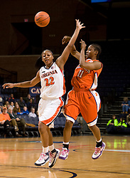 Clemson guard/forward Lele Hardy (11) passes behind Virginia guard Monica Wright (22).  The Virginia Cavaliers women's basketball team defeated the Clemson Tigers 83-71 at the John Paul Jones Arena in Charlottesville, VA on February 21, 2008.
