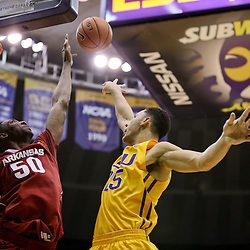 Jan 16, 2016; Baton Rouge, LA, USA; LSU Tigers forward Ben Simmons (25) shoots over Arkansas Razorbacks center Willy Kouassi (50) during the second half of a game at the Pete Maravich Assembly Center. LSU defeated Arkansas 76-74. Mandatory Credit: Derick E. Hingle-USA TODAY Sports