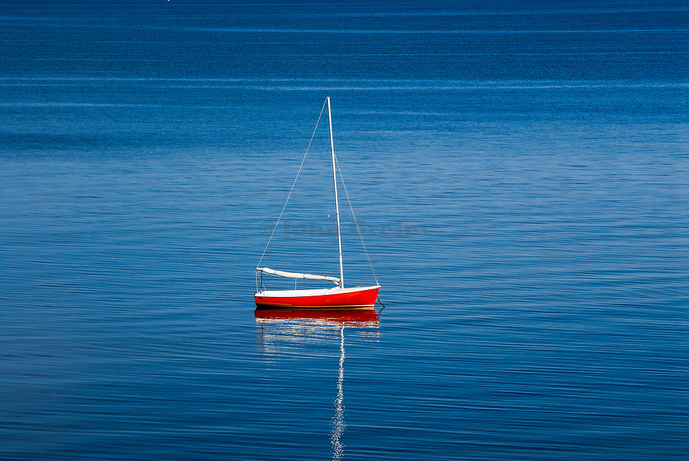 Sailboat moored in Cape Cod Bay, Eastham, Massachusetts, USA.