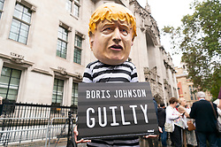 © Licensed to London News Pictures. 24/09/2019. London, UK.  A Pro-remain supporter dressed at British prime minister Boris Johnson is outside the Supreme Court after it had ruled prorogation by the British government was unlawful. Photo credit: Ray Tang/LNP