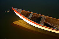 Reflection of row boat in still waters of Lake Chapala, Mexico