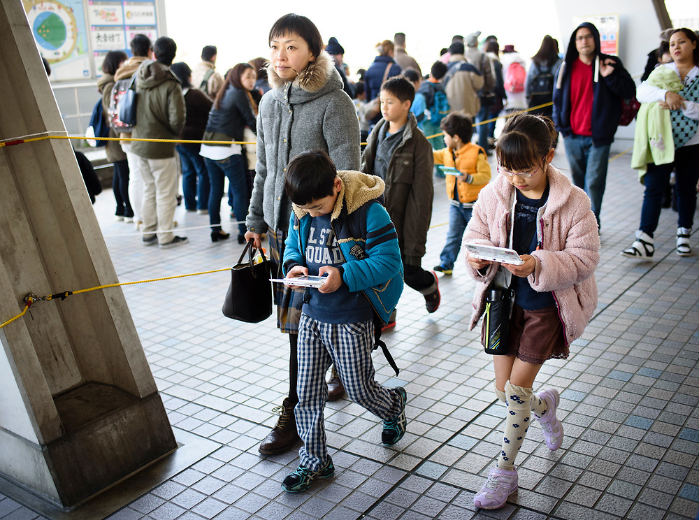 Children play games at the Next Generation World Hobby Fair at Nagoya Dome in Nagoya, Japan. Organizers estimated between 30,000 and 40,000 people visited the fair, and similar events were held in Tokyo, Osaka, and Fukuoka. Japan has the world's largest mobile gaming market, topping $6 billion in revenues in 2015.