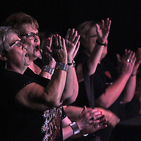 Elvis fans cheer at the end of Elvis Tribute Artist Mark Anthony's performance Friday during round one of the Ultimate Elvis Tribute Artist Competition Friday morning at the BancorpSouth Arena.