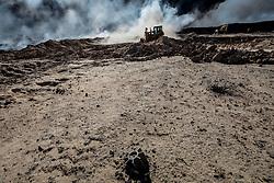 November 23, 2016 - Qayyara, Ninewa Province, IRAQ - An unexploded mortar lies close to the firefighting efforts. (Credit Image: © Gabriel Romero via ZUMA Wire)