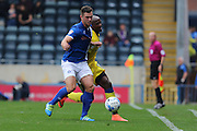 AFC Wimbledon striker Tom Elliott (9) and Rochdale FC defender Harrison McGahey (6) tangle during the EFL Sky Bet League 1 match between Rochdale and AFC Wimbledon at Spotland, Rochdale, England on 27 August 2016. Photo by Stuart Butcher.