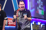 Kim Huybrechts hits a double and wins a leg and celebrates during the PDC William Hill Darts World Championship at Alexandra Palace, London, United Kingdom on 13 December 2019.