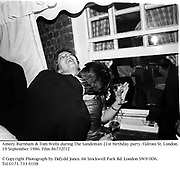 Amery Burnham & Tom Wells during The Sandeman 21st birthday party. Culross St. London. 19 September 1986. Film 86732f12<br />