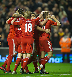 LIVERPOOL, ENGLAND - Tuesday, March 13, 2012: Liverpool's captain Steven Gerrard celebrates scoring an injury time third goal, the third of his hat-trick of goals against Everton on his 400th Premier Leagie appearance during the Premiership match at Anfield. Liverpool won 3-0 and Gerrard became the first player since Ian Rush in 1982 to score a hat-trick in a Merseyside Derby. (Pic by David Rawcliffe/Propaganda)