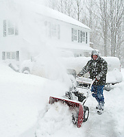 "Jerry Cotnoir starts snow blowing approximately 18"" of new snow from his driveway on Liberty Hill in Gilford Wednesday afternoon as the Nor'Easter stormed through.   (Karen Bobotas/for the Laconia Daily Sun)"