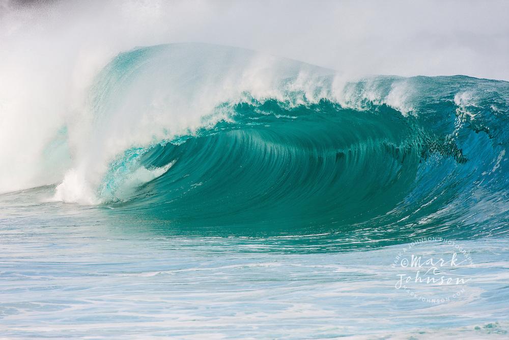 Giant wave breaking at Waimea Bay shorebreak, North Shore, Oahu, Hawaii