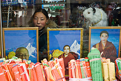 Tibet New Year - China - Edward Wong<br /> A local shop sells religious items  in Rebkong (Tongren in Chinese), Qinghai province in China, February 24, 2009. Photo by Shiho Fukada for The New York Times