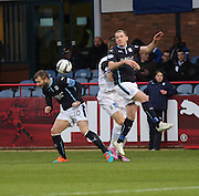 Dundee's Gary Irvine outjumps Inverness' Marley Watkins - Dundee v Inverness Caledonian Thistle, SPFL Premiership at Dens Park <br /> <br />  - &copy; David Young - www.davidyoungphoto.co.uk - email: davidyoungphoto@gmail.com