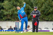 Afghan cricketer Sharafuddin Ashrad bowls during the One Day International match between Scotland and Afghanistan at The Grange Cricket Club, Edinburgh, Scotland on 10 May 2019.