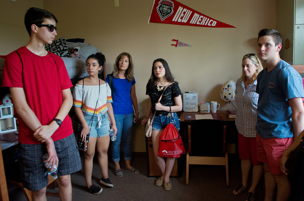 mkb070517e/metro/Marla Brose -- A group of prospective University of New Mexico students crowd into a a dorm room in Hokona Hall during a campus tour, July 5, 2017, in Albuquerque, N.M. (Marla Brose/Albuquerque Journal)