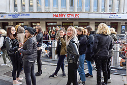 © Licensed to London News Pictures. 29/10/2017. London, UK.  Fans of singer, Harry Styles, in the queue for 'merch' (merchandise) outside the Hammersmith Eventim Apollo in West London ahead of his first UK solo shows taking place on 29 and 30 October.  Many fans, eager to secure a space as close to the stage as possible have queued overnight, sleeping on the pavement in their sleeping bags or under duvets.  Fans immediately outside the entrance to the venue (pictured) will be seeing the singer perform on the 29 October, whilst those under the nearby Hammersmith flyover have arrived a day early with tickets for 30 October.  Photo credit: Stephen Chung/LNP