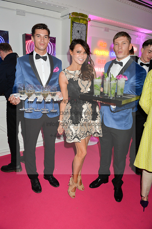 LIZZIE CUNDY and waiters at Light Up Your Life - a party hosted by Lillingston held at Lights of Soho, 35 Brewer Street, London on 1st October 2015.