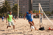 YOUNG MEN PLAYING FOOTBALL COPACABANA BEACH RIO