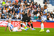 Aaron Mooy of Huddersfield Town (10) tackles Tom Lawrence of Derby County (10) during the EFL Sky Bet Championship match between Huddersfield Town and Derby County at the John Smiths Stadium, Huddersfield, England on 5 August 2019.