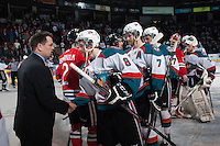 KELOWNA, CANADA - APRIL 25: Karl Taylor, assistant coach of the Portland Winterhawks shakes hands with Colten Martin #8 of the Kelowna Rockets on April 25, 2014 during Game 5 of the third round of WHL Playoffs at Prospera Place in Kelowna, British Columbia, Canada. The Portland Winterhawks won 7 - 3 and took the Western Conference Championship for the fourth year in a row earning them a place in the WHL final.  (Photo by Marissa Baecker/Getty Images)  *** Local Caption *** Karl Taylor; Colten Martin;
