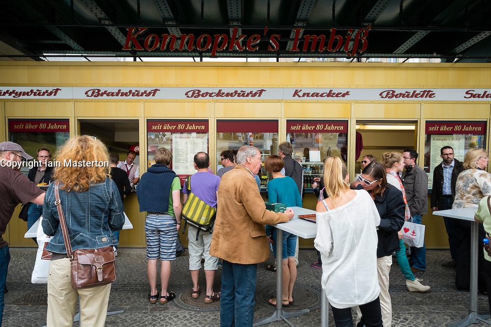 Famous currywurst kiosk Konnopke's Imbiss in bohemian Prenzlauer Berg district of Berlin Germany