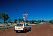 Dale Johnson playing 'Lost'  on an Australian Outback road, April 2001