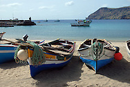 Brightly painted open wooden fishing boats hauled up on the beach Tarrafal, North west Santiago, Cape Verde Islands (Cabo Verde).   Tarrafal, or Villa de Tarrafal,  is a small fishing port on the north western tip of Santiago.  It has a beautiful sandy beach.