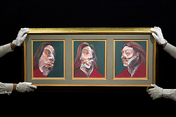 © Licensed to London News Pictures. 14/06/2013. London, UK. Members of Sotheby's staff hold Francis Bacon's 'Three Studies of Isabel Rawsthorne' (1966, est. GB£10,000,000-15,000,000) at the press view for a Sotheby's auction in London today (14/06/2013). The Contemporary Art Evening Sale takes place on the 26th of June 2013 at Sotheby's New Bond Street premises.  Photo credit: Matt Cetti-Roberts/LNP